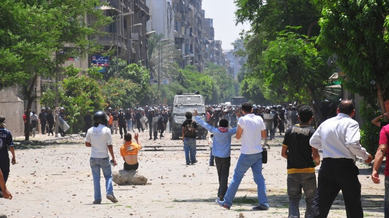 """The pictures, videos and first-hand accounts that emerged after the clashes ended, provided damning evidence that the police force unlawfully used firearms. The police force's use of firearms broke both Egyptian and international law, according to an Amnesty International report. The attempt to forcefully break up the peaceful protest on 19 November is in direct violation of article 21 of the International Covenant on Civil and Political Rights (which Egypt is party to) ensures the """"right of peaceful assembly"""" with no restrictions. There has been no feasible justification for the use of force against the peaceful protesters, as they were not posing a threat to national security, public safety or public order. Hassan Ibrahim"""