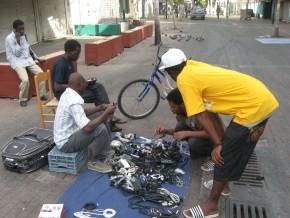 East African street vendors sell black market goods on Neve Sha'anan street in Tel Aviv Connor Molloy / Daily News Egypt