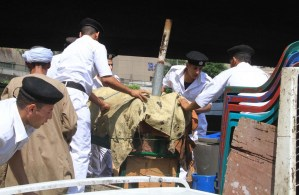 Police officers remove the carts and stalls of street vendors during an operation along the Nile cornice Mohamed Omar