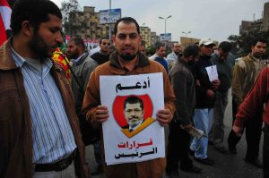 President Morsy supporters demonstrate by Rabaa Al-Adawiya Mosque in Heliopolis (Photo by Hassan Ibrahim)