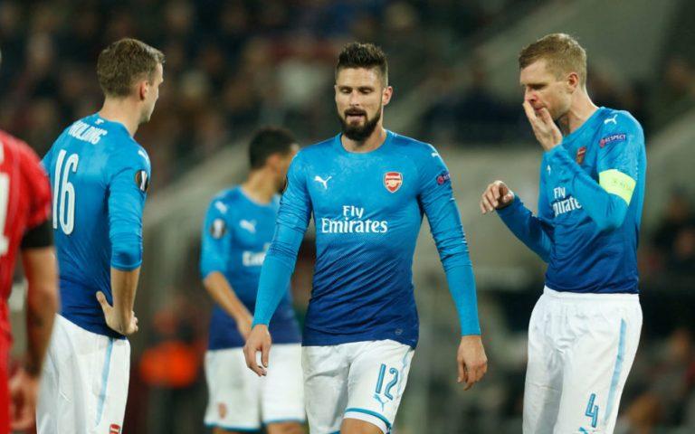 Arsenal lose at Cologne, Milan make last 32