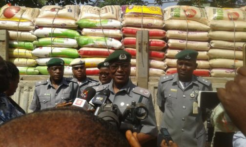 Customs impounds Dangote cement truck with bags of rice