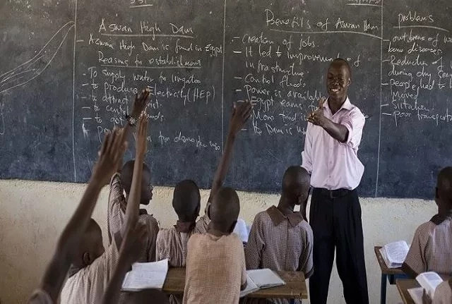 Nigerian teacher with pupils