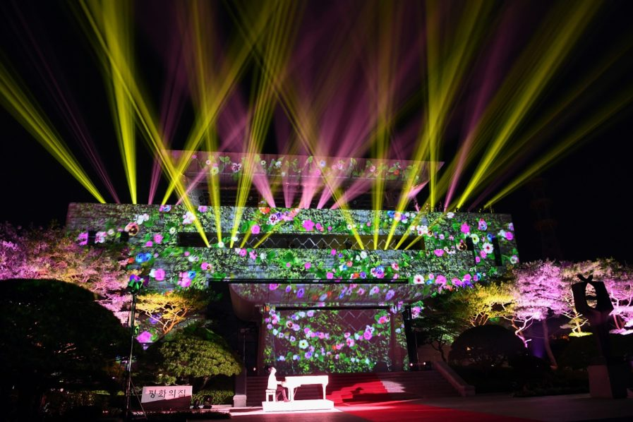 (FILES) In this file photo taken on April 27, 2018, an image of flowers is beamed onto the Peace House where the summit between North Korea's leader Kim Jong Un and South Korea's President Moon Jae-in had taken place, during a closing ceremony at the end of their historic summit at the truce village of Panmunjom. A US delegation was holding talks with North Korean officials on May 27, 2018, at th border truce village od Panmunjom amid preparations for a summit between the two countries' leaders,US State Department spokeswoman Heather Nauert said in a statement. / AFP PHOTO / Korea Summit Press Pool / -
