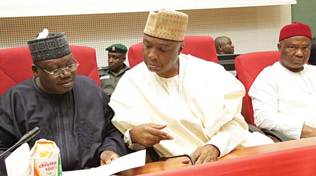 Senate Leader Ahmad Lawan (left) Senate President Abubakar Bukola Saraki and Chairman Senate Committee on Customs Excise and Tariffs Hope Uzodinma