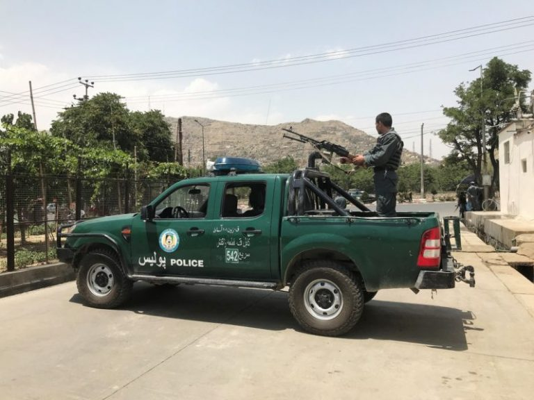 Gunmen kill at least 28 in raid on Afghan government building
