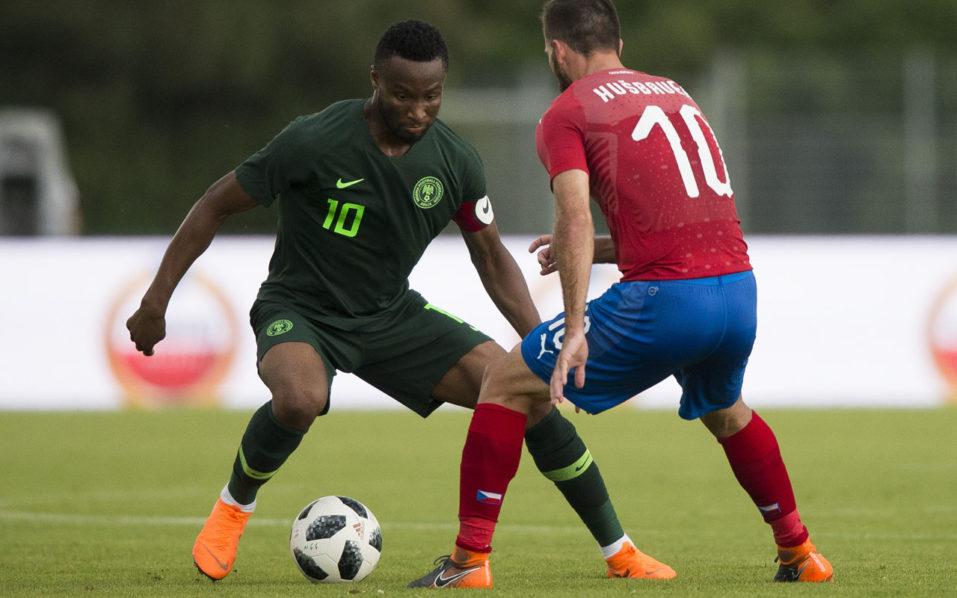 Nigeria's midfielder John Obi Mikel (L) and Josef Husbauer (R) of Czech Republic vie for the ball during the international friendly football match between Nigeria and Czech Republic in Rannersdorf, Austria on June 6, 2018. / AFP PHOTO / VLADIMIR SIMICEK