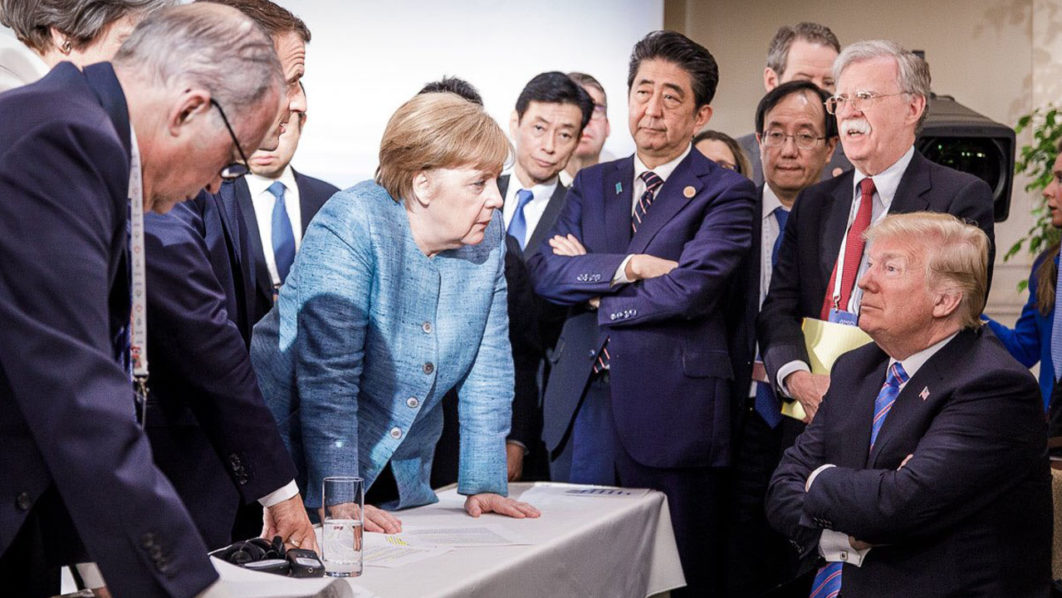 Photo released on Twitter by the German Government's spokesman Steffen Seibert on June 9, 2018 and taken by the German government's photographer Jesco Denzel shows US President Donald Trump (R) talking with German Chancellor Angela Merkel (C) and surrounded by other G7 leaders during a meeting of the G7 Summit in La Malbaie, Quebec, Canada. The photo went viral, popping up all over social media, sometimes in its original form sometimes altered for humorous or satirical ends. / AFP PHOTO / Bundesregierung / Jesco DENZEL /