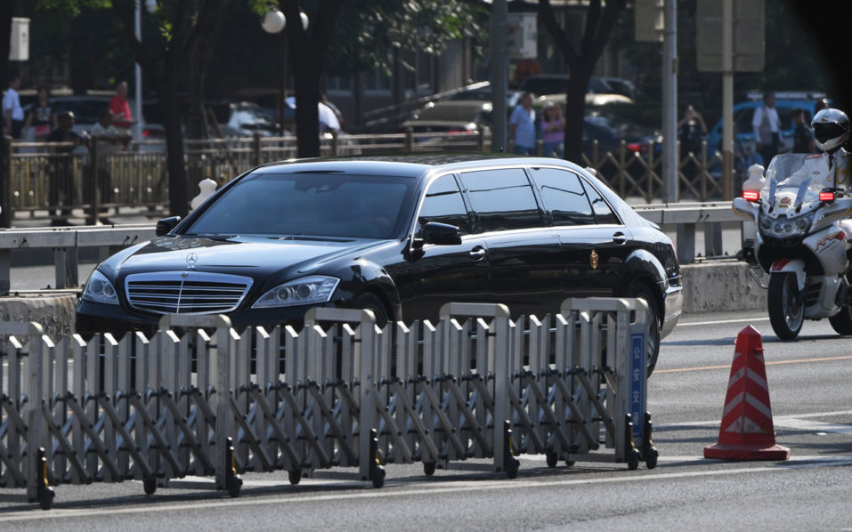 The car believed to be carrying North Korean leader Kim Jong Un is escorted by motorcycles in Beijing on June 19, 2018. North Korean leader Kim Jong Un began a two-day visit to Beijing on June 19 in what analysts believe is a trip to brief his sole major ally on his unprecedented summit with US President Donald Trump and seek consensus on next steps in negotiations with Washington. / AFP PHOTO / GREG BAKER