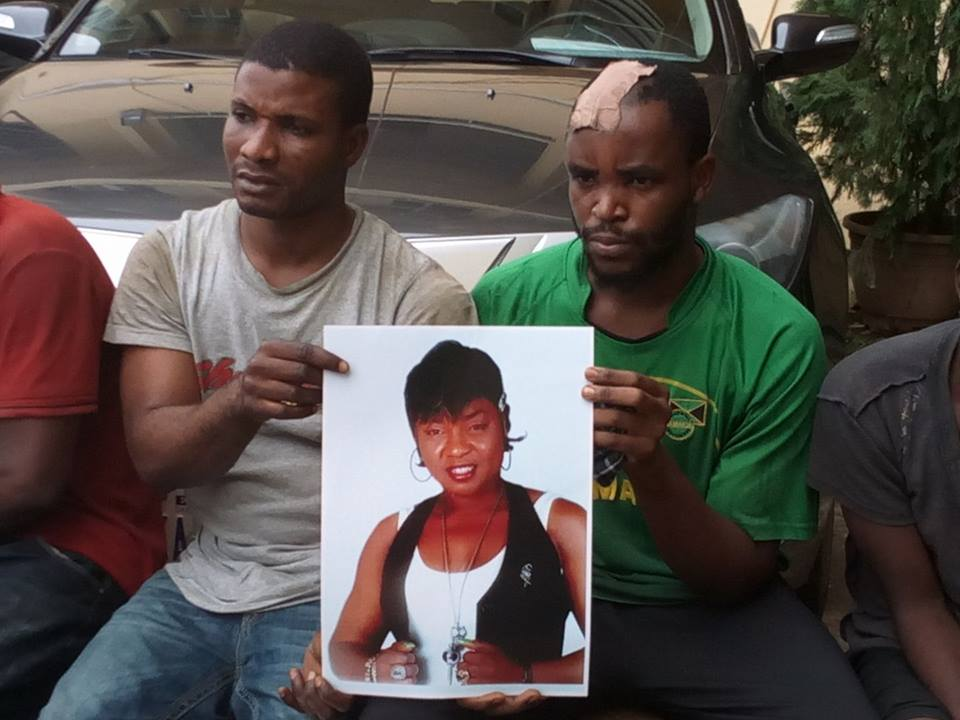 Chukwujekwu Ezeugo, 27, and Emmanuel Adogah, 28, holding Charity Aiyedogbon's picture