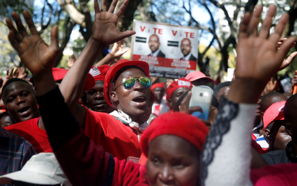 Members of Zimbabwe's opposition parties hold placards during a march to the Zimbabwe Electoral Commission (ZEC) headquarters to demand reforms critical for a credible, free and fair elections ahead of the July 30 elections in Harare, Zimbabwe, July 11,2018. REUTERS/Philimon Bulawayo