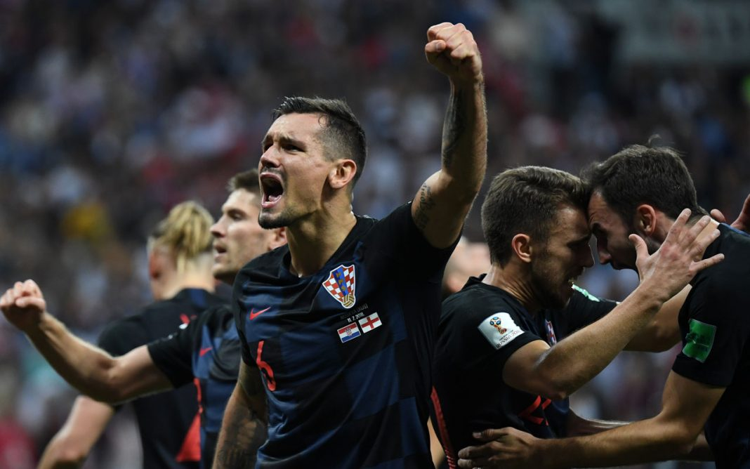 Croatia's defender Dejan Lovren (C) celebrates with teammates at the end of the Russia 2018 World Cup semi-final football match between Croatia and England at the Luzhniki Stadium in Moscow on July 11, 2018. / AFP PHOTO / YURI CORTEZ /