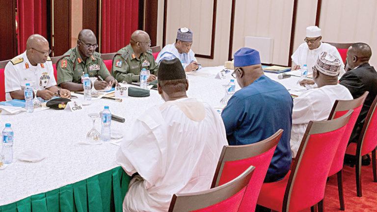 Security chiefs meet with Buhari, keep mum