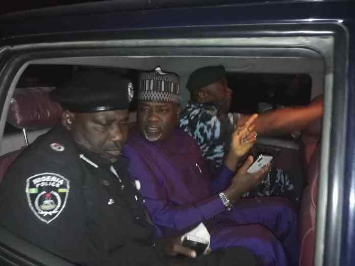 Deputy governor Nasiru Gawuna sandwiched between two policemen being taken to Kano Police Command headquarters, Bompai.