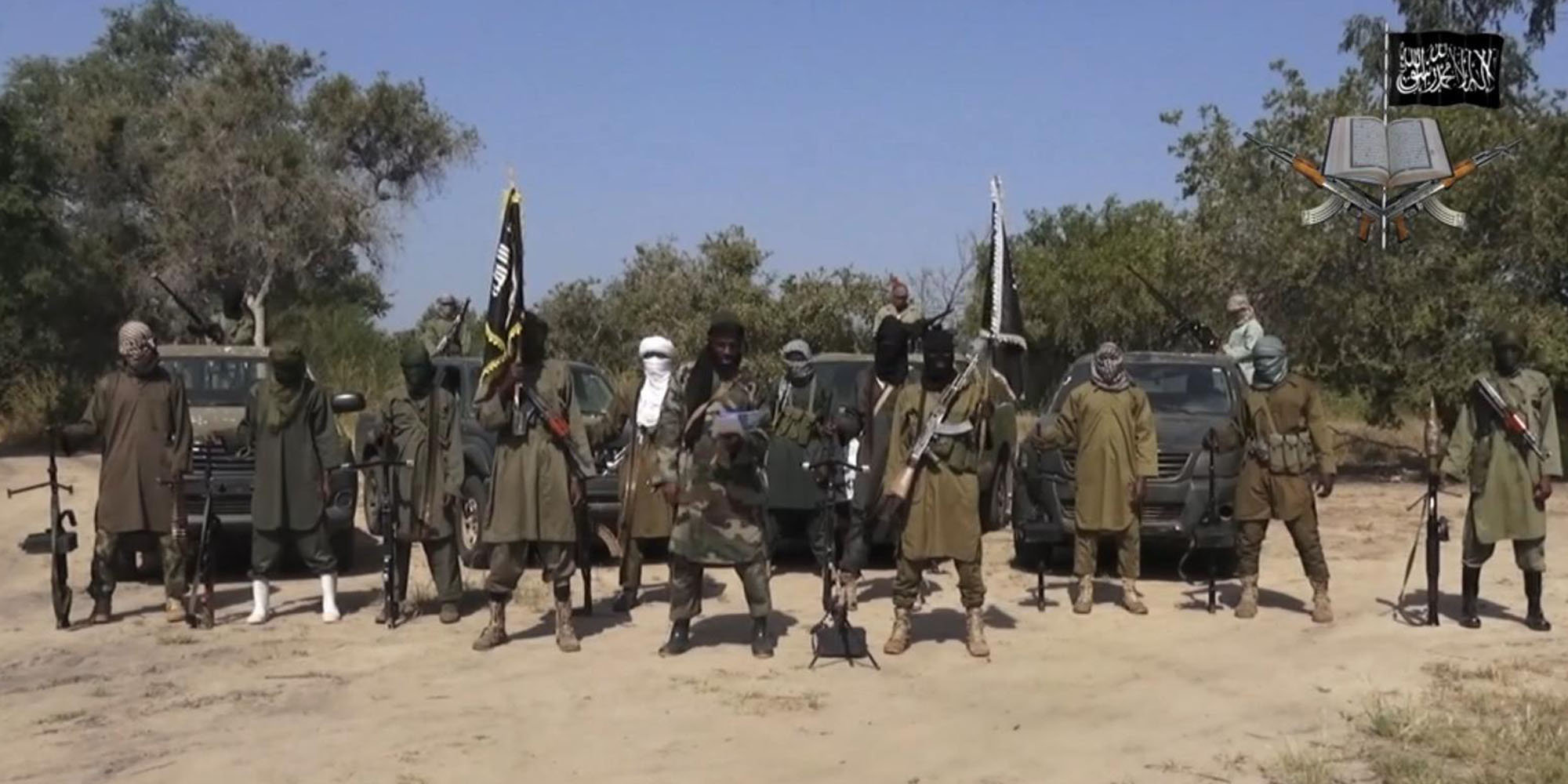FILE - In this file image taken from video released late Friday evening, Oct. 31, 2014, by Boko Haram, Abubakar Shekau, centre, the leader of Nigeria's Islamic extremist group. Boko Haram fighters have shot or burned to death about 90 civilians and wounded 500 in ongoing fighting in a Cameroonian border town near Nigeria, officials in Cameroon said Thursday, Feb. 5, 2015. (AP Photo/Boko Haram,File)