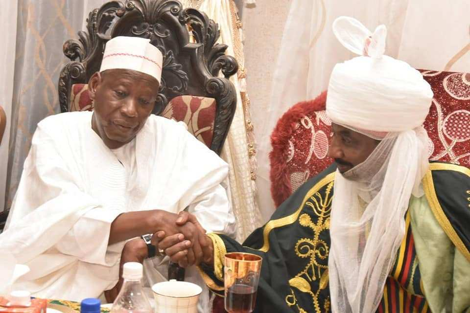 FILE PHOTO: Governor Abdullahi Umar Ganduje shaking Emir Muhammadu Sanusi II