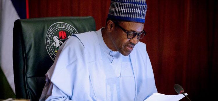 Buhari swears in RMAFC chairman, commission members