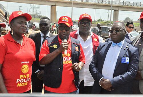 From left: Past District Governor/ Zonal Coordinator for Africa End Polio Now, Ijeoma Pesu Okoro; Rotary International Polio Ambassador in Africa, Sir Emeka Offor; and the District Governor 2019-2020 Rotary International District 9125, Victor Onukwugha at the unveiling of Special Polio Billboard to mark the World Polio Day along Airport Road at Lugbe in Abuja on Wednesday
