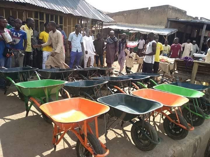 Maigari Bello-Kasimu donates wheelbarrows to youths in Adamawa