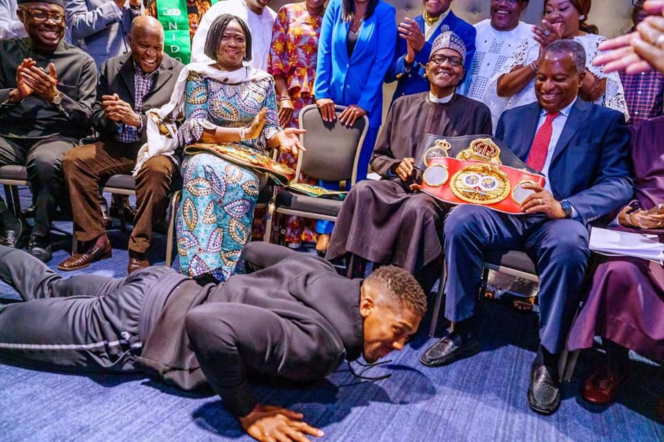 Heavyweight champion Anthony Joshua prostrates before President Muhammadu Buhari in London on January 18, 2020