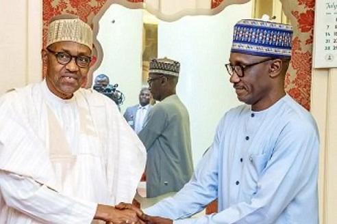 President Muhammadu Buhari shaking hands with GMD NNPC, Mele Kyari