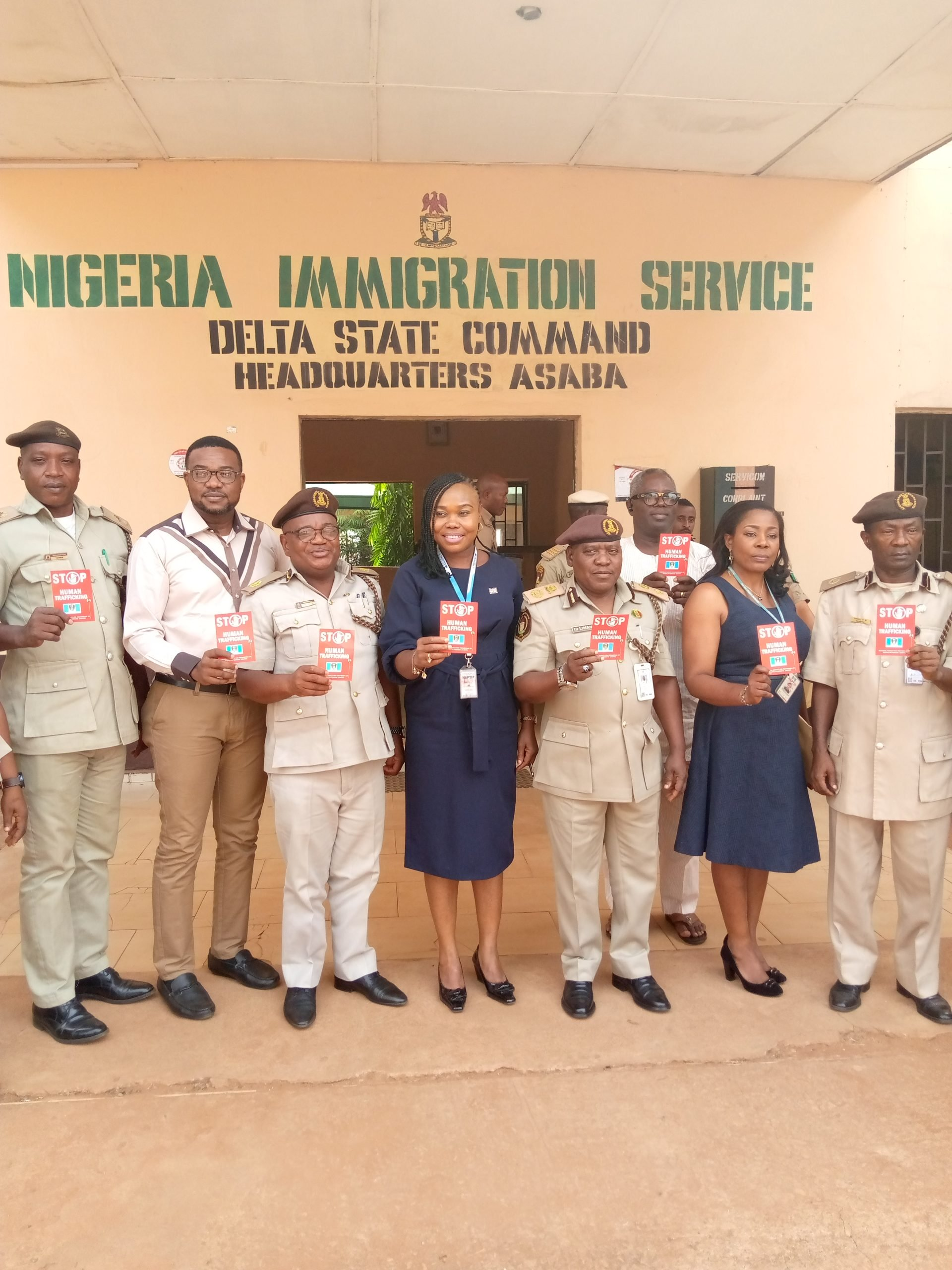 The Zonal Commander of NAPTIP, Mrs Ijeoma Uduak (Centre) with the Comptroller of Nigeria Immigration Service (NIS), Ibrahim Liman, with other officers of NAPTIP and officers of NIS in Asaba on Tuesday.