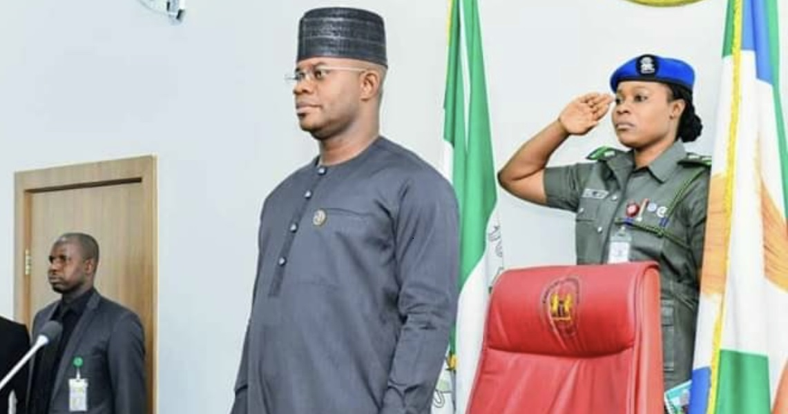 ASP Ifeoma Akaya salutes behind Governor Yahaya Bello of Kogi State at a function recently.