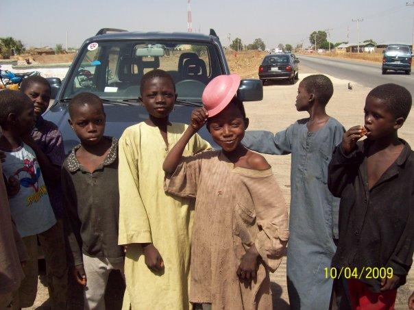 FILE PHOTO: Almajiris hanging around a filling station and begging in Magam Huguma, Bauchi State. Credit: Mustapha Shehu Mustash