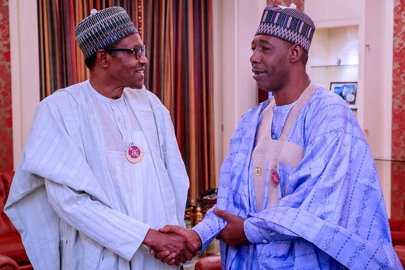 President Muhammadu Buhari (left) in handshake with the governor of Borno State, Babagana Zulum