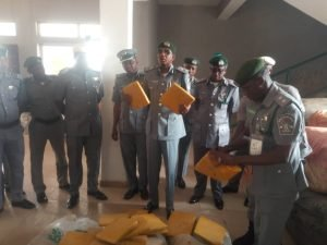 """Mustapha Sarkin-Kebbi, Comptroller of the Nigerian Customs Service Zone """"B"""" Federal Operation Unit, displaying intercepted parcels of Indian Hemp on Thursday in Kaduna"""