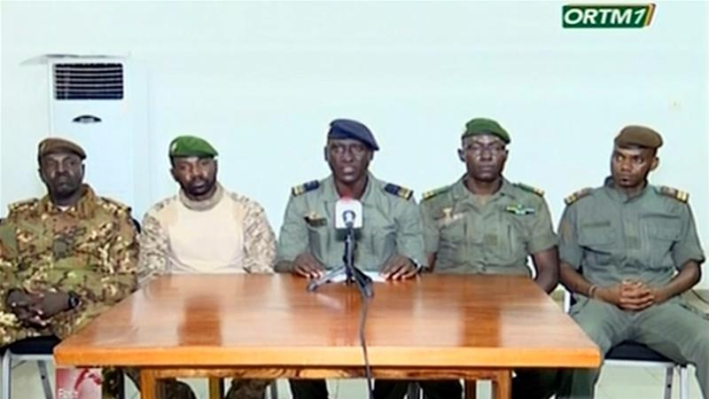 Colonel-Major Ismael Wague, centre, announces the takeover of Mali on Wednesday on state television