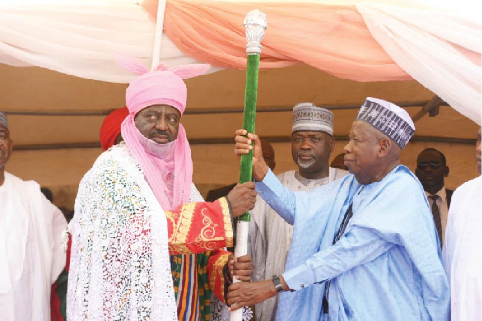 Governor Abdullahi Ganduje-presents-staff-of-office-to-Emir of Kano Aminu Ado