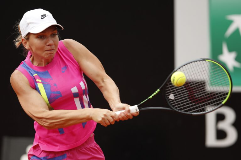 Halep wins Italian Open after Pliskova retires with injury