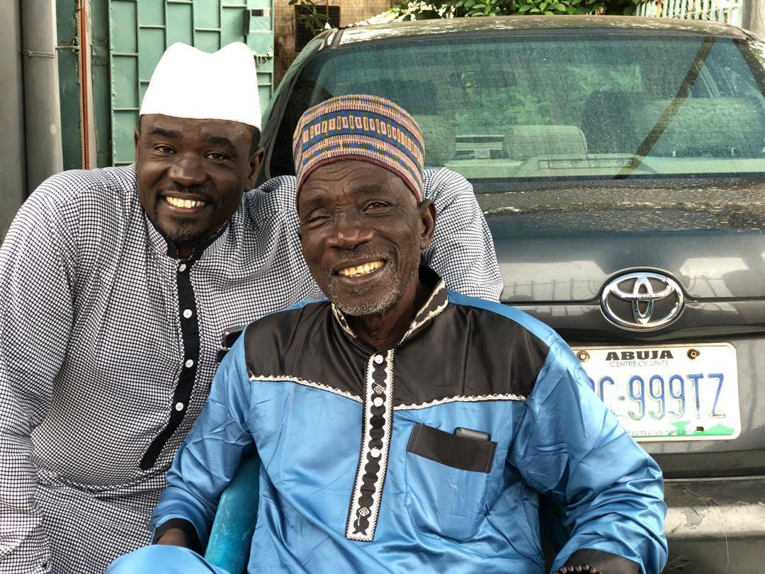 Yushau Shuaib (left) with his father, Dr Abdulhamid Agaka