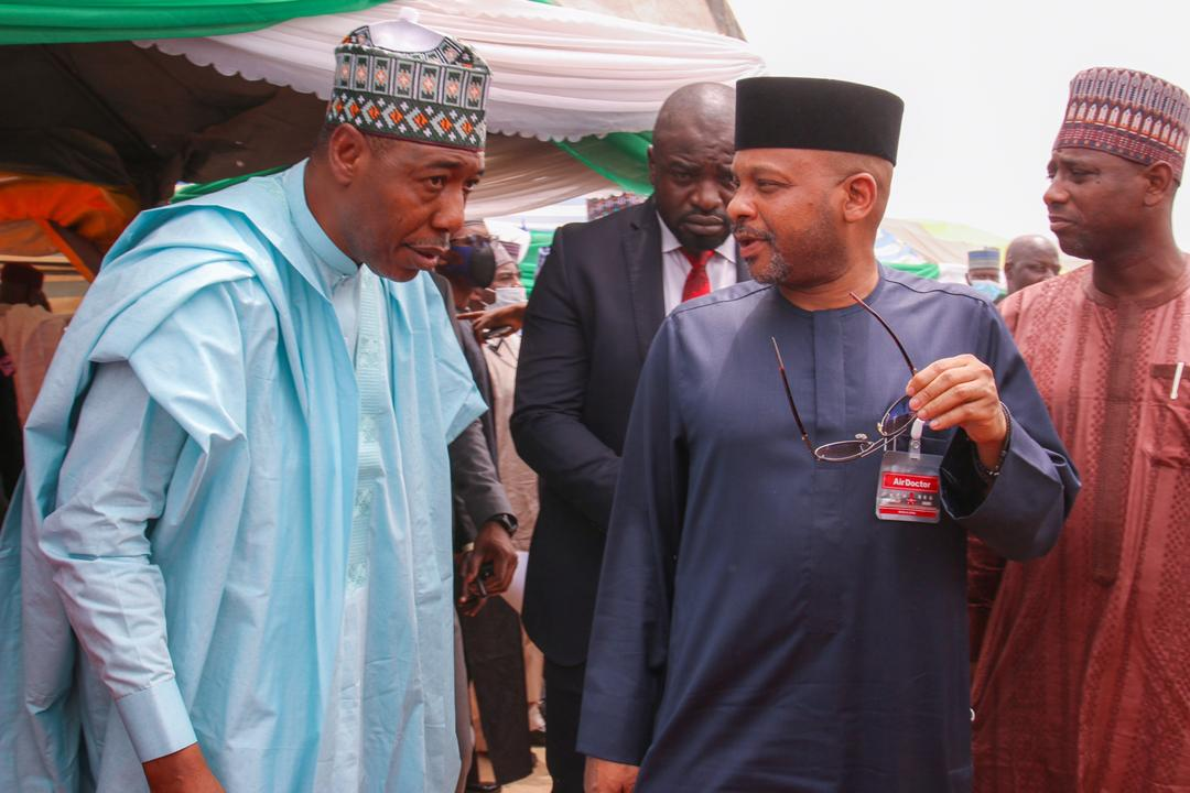 [CAPTION]: NCFRMI Federal Commissioner, Sen. Basheer Garba Mohammed, chatting with Borno State governor, Prof. Babagana Zulum during the flag-off of the verification exercise of over 350, 000 IDPs who will benefit from the agency's Project Reliance.