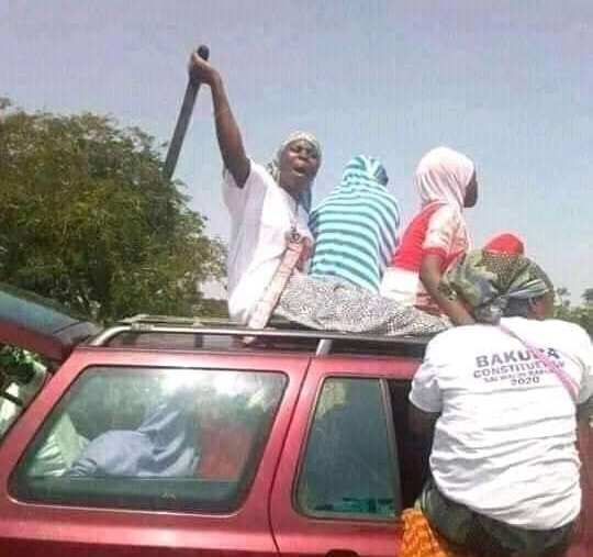A woman brandishes machete during the Bakura by-election campaign in Zamfara State
