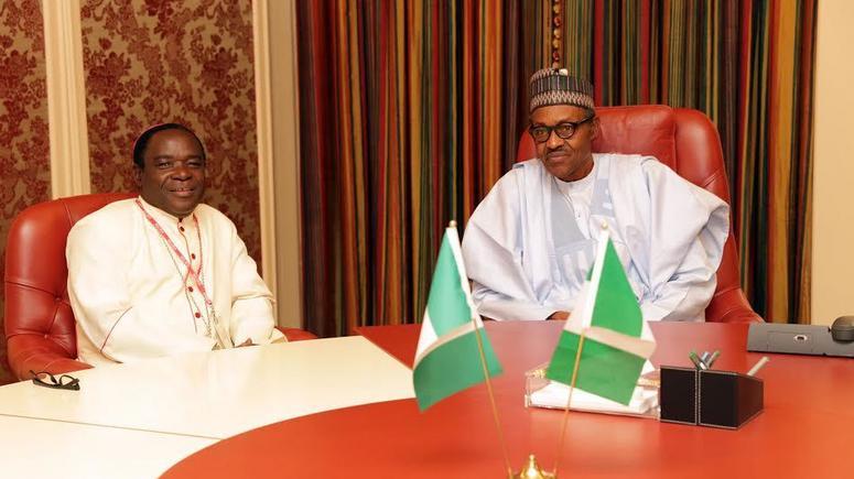 FILE: President Buhari and Bishop Kukah at the Presidential Villa