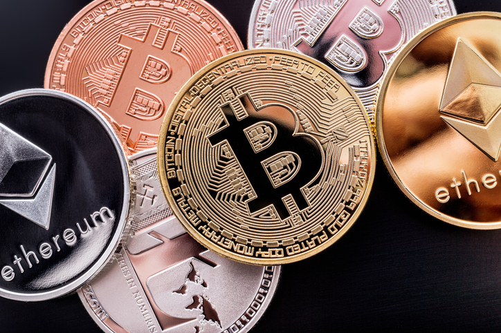 Montreal, Canada - 28 February 2018: Stacked cryptocurrency coins (Bitcoin, Ethereum, Litecoins)