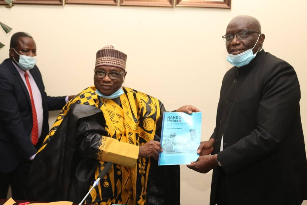 Outgoing Vice-Chancellor of the National Open University of Nigeria (NOUN), Professor Abdalla Uba Adamu (left), handing the affairs of the university to his successor, Professor Femi Peters, at a formal handover ceremony held at the university headquarters in Abuja on Thursday, 11th February, 2021
