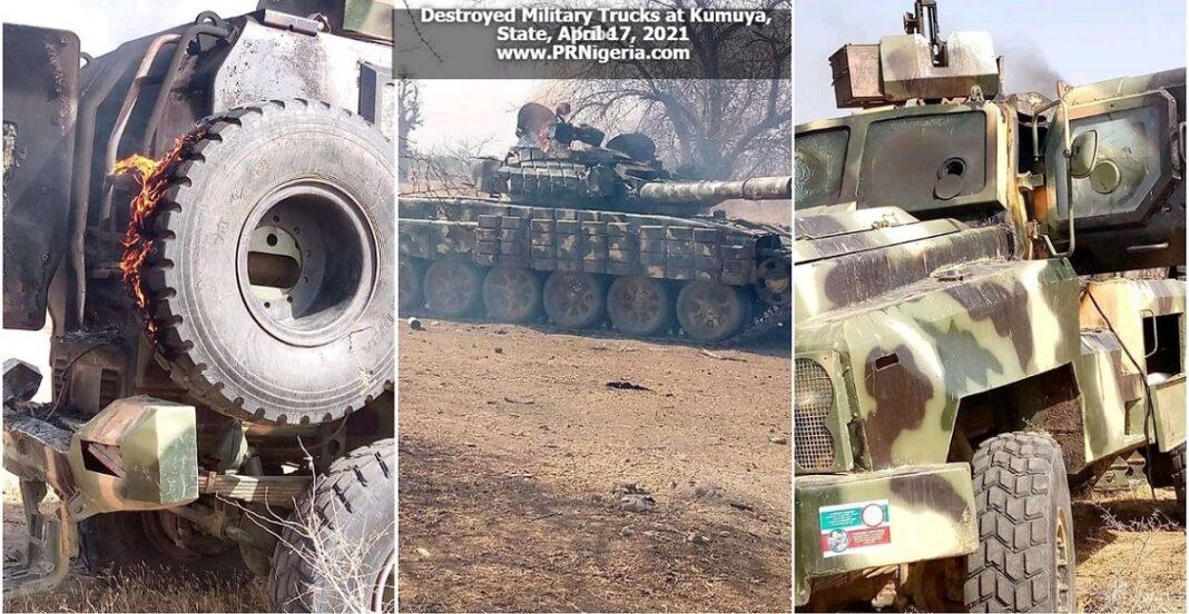 Destroyed trucks at Kumuya Military Base April 2021