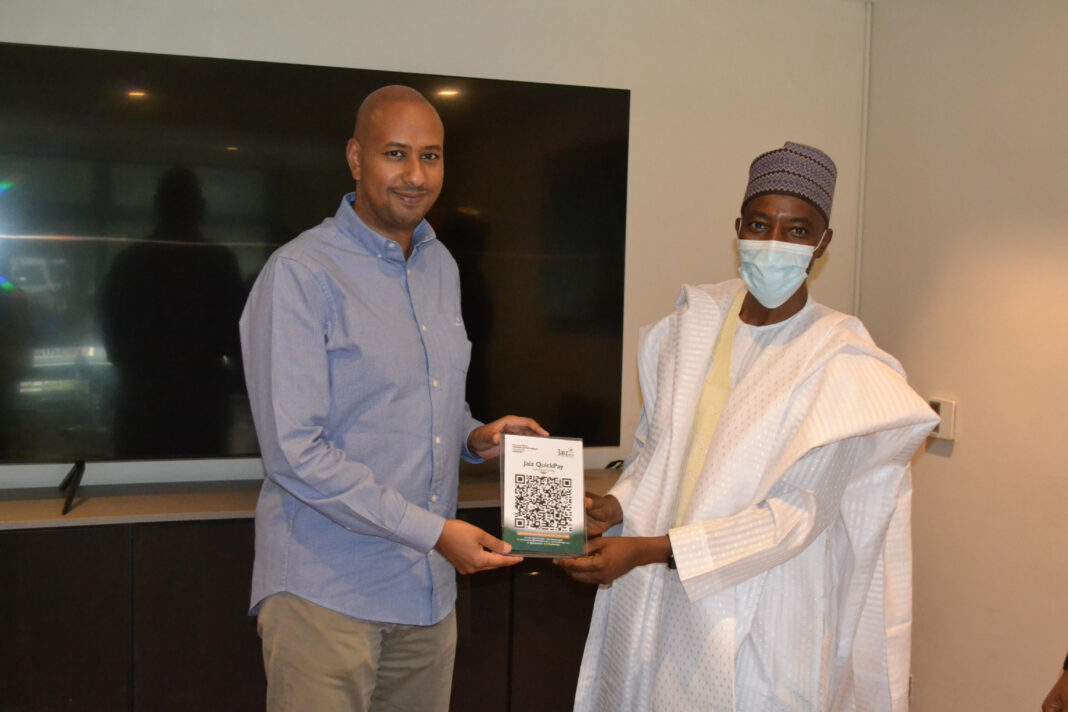 From right: Managing Director/CEO of Jaiz Bank, Hassan Usman, presenting the NQR Platform to the Managing Director of Fraser Suites , M.G Nasreddin, Abuja.