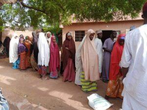 Fasting Muslims receiving food from Sokoto Ramadan Feeding committee