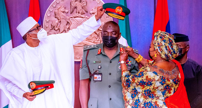 President Muhammadu Buhari (L) assisted by Vice President Yemi Osinbajo while decorating the Chief of Army Staff, Maj-Gen Ibrahim Attahiru with his new Rank of Lieutenant General at the Presidential Villa in Abuja on Friday (5/3/2021) NAN/DAILY NIGERIAN