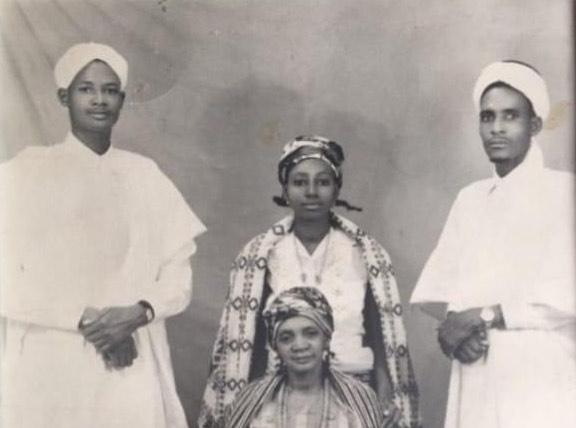 Alhaji Aminu Dantata (first left), late Hajiya Bara Dantata (standing middle), late Alhaji Ahmadu Dantata (first right) and their mother, late Hajiya Umma Zaria (sitting).