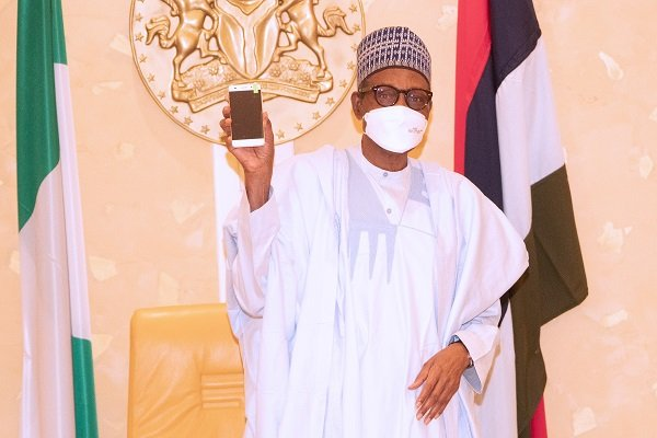 President Buhari presented with Nigerian-Made cell phone