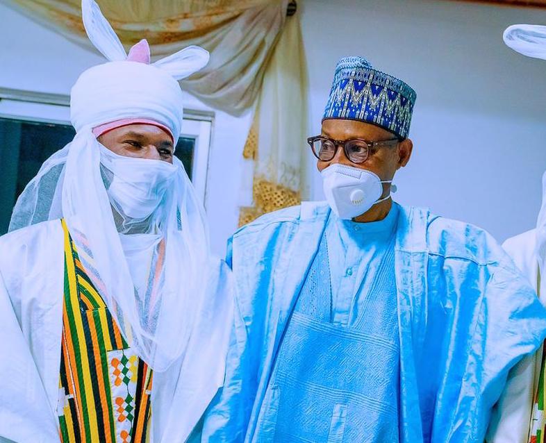 Yusuf Buhari in royal dress with President Muhammadu Buhari
