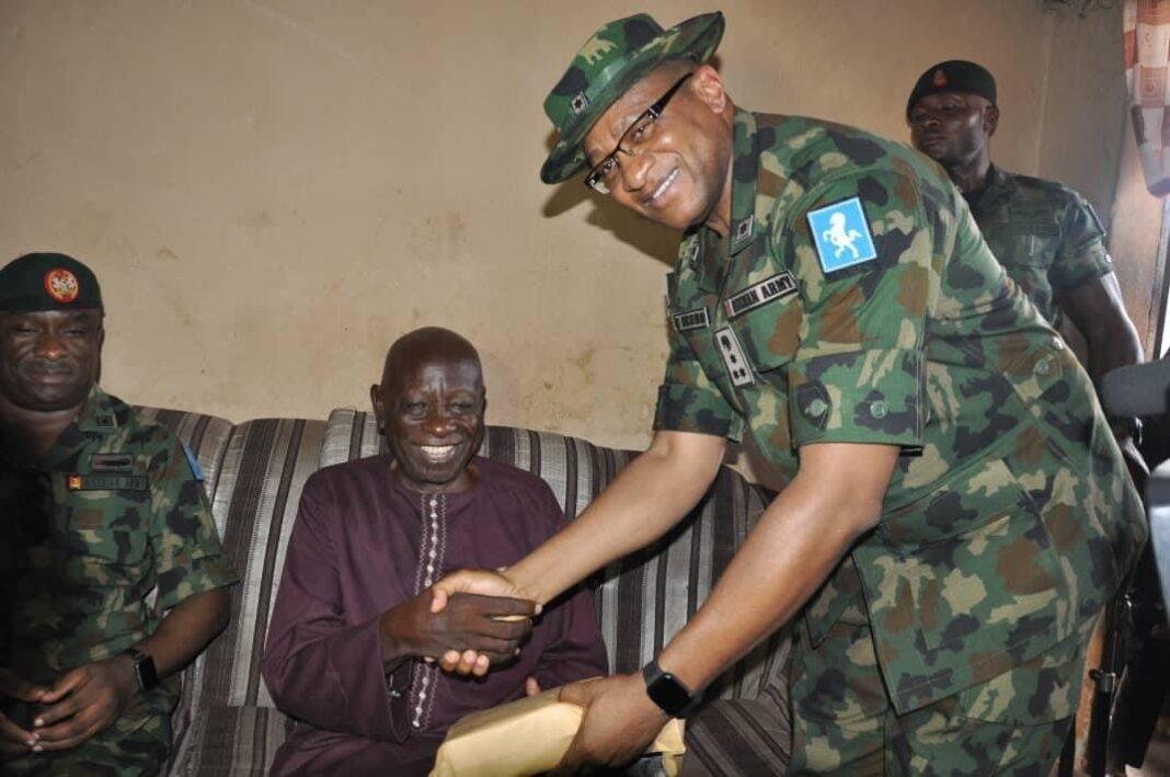 Representative of Chief of Army Staff, Brig.-Gen Vitalis Okoro handing over the money to veteran actor Usman Baba-Pategi, popularly known as Samanja, on Monday in Kaduna July 5, 2021.