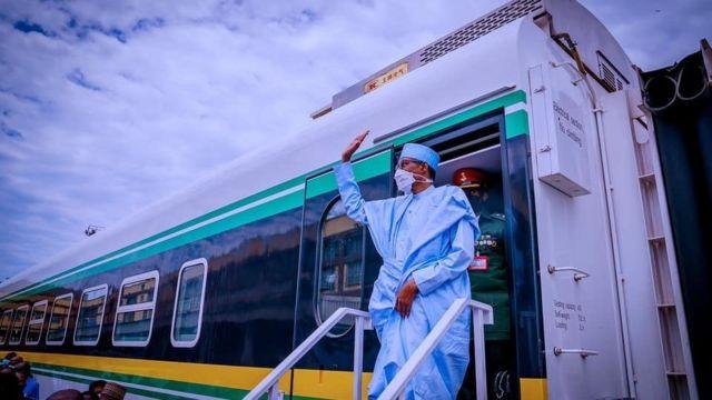 FILE: President Muhammadu Buhari alighting from a train