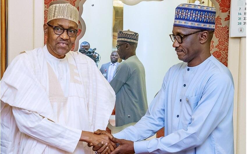 President Muhammadu Buhari in handshake with GMD NNPC Mele Kyari