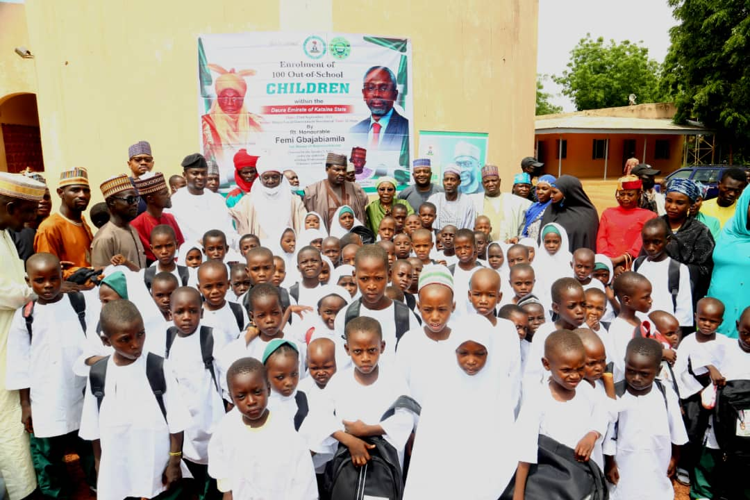Some of the beneficiaries of the enrolment of 100 out-of-school children into primary schools in Daura, Katsina State by Gbaja Professionals Volunteer Network with some guests during the enrolment programme in Daura on Wednesday, September 23, 2021. Photo: Speaker's Media Unit.